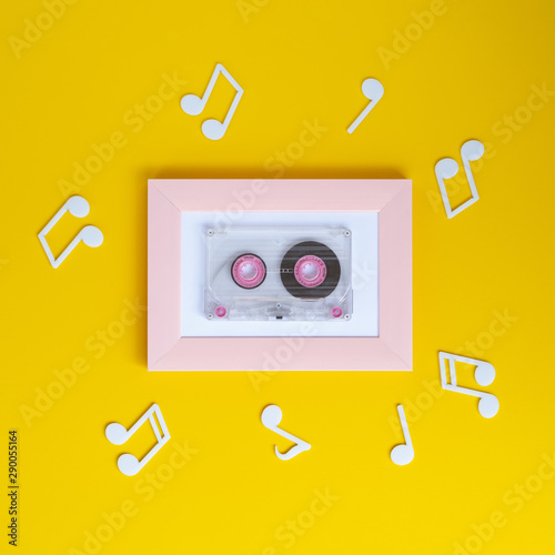 Bright colorful cassette tape with musical notes around it - 290055164