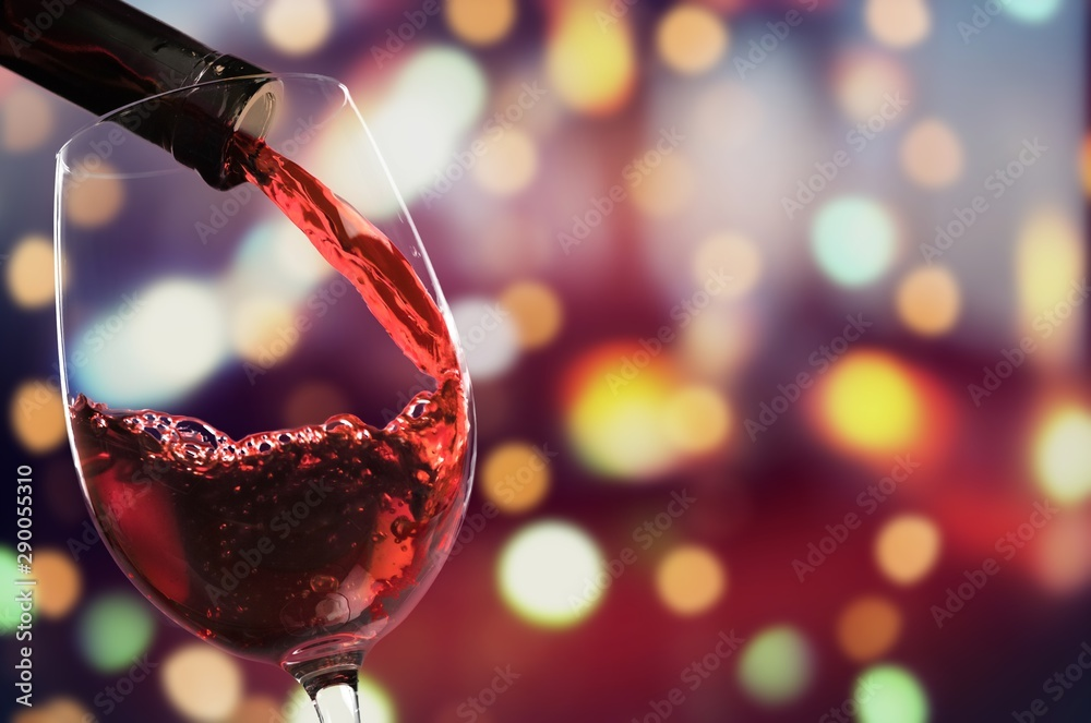 Fototapety, obrazy: Red wine pouring in glass on  background