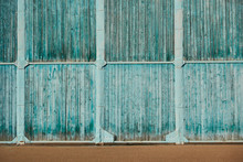 The Wall Of The Old Hangar Of Wooden Panels On A Metal Frame