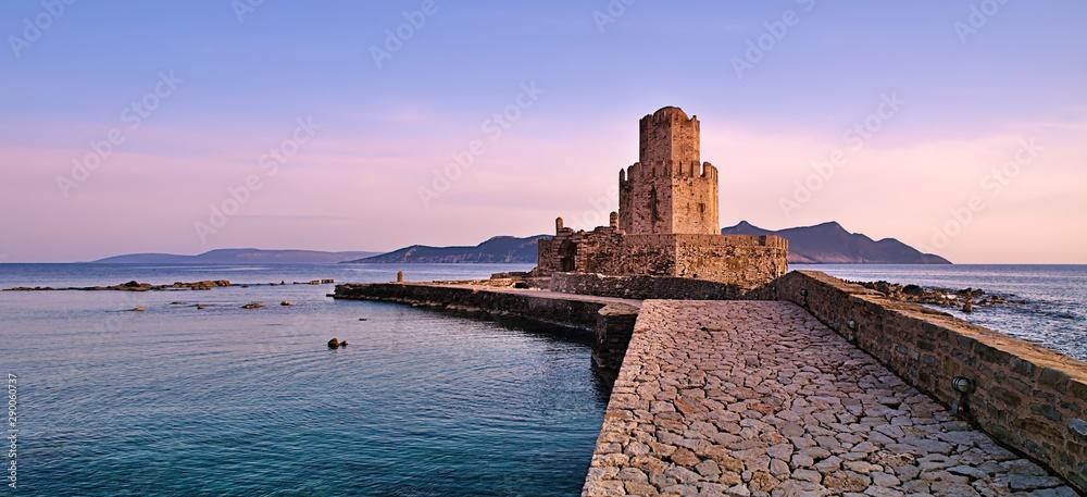 Fototapeta Impressive three-tiered watchtower, Venetian fort castle of Methoni, Greece at sunset time.