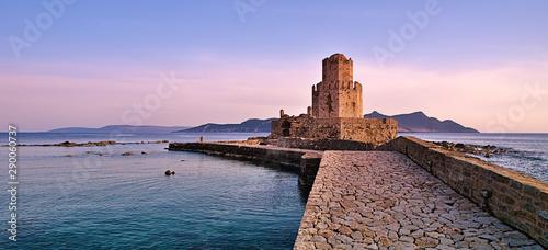 Poster de jardin Europe Méditérranéenne Impressive three-tiered watchtower, Venetian fort castle of Methoni, Greece at sunset time.