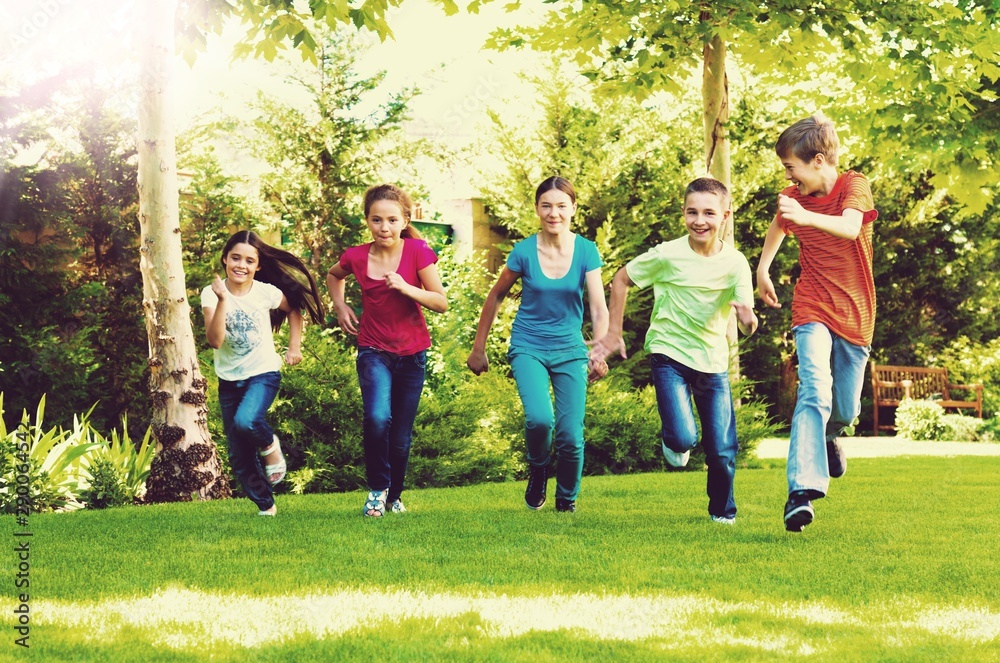 Fototapety, obrazy: Happy  children running and playing in garden on sunny day
