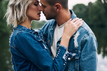 Young Loving Couple Kissing An...