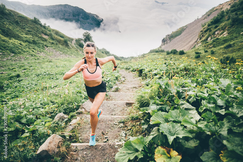 Deurstickers Olijf Woman running and jogging in the nature mountain scenery. Concept of healthy lifestyle. Fitness spot girl training in mountain.