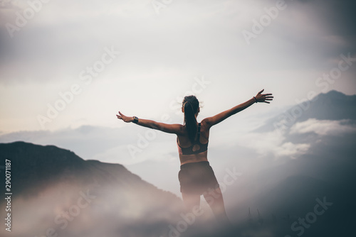 Fotografiet Running woman on top of mountain happy and celebrating success