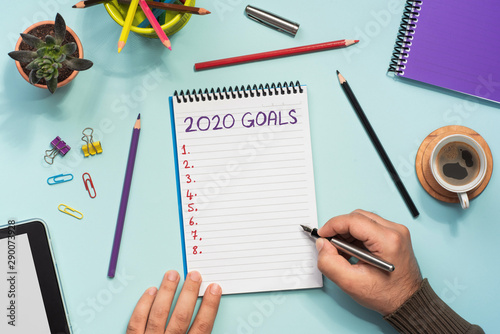 Photo  To Do list For New Year 2020, Over Head View Of Work Desk.