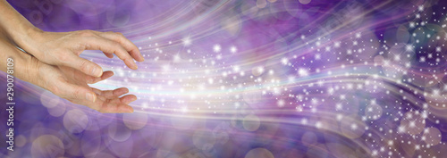 Sending you beautiful healing energy vibes - female cupped hands with a whoosh of white energy lines flowing outwards and sparkles on a purple bokeh background with copy space