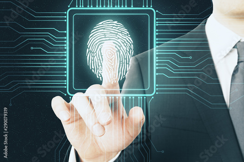 Photo Digital protection concept with digital screen with microchip and fingerprint pushing by businessman