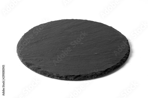 Fotografía  Black round stone plate isolated on white