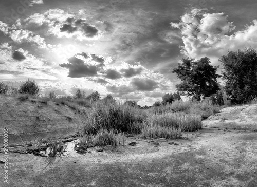 Poster Gris The water dam in Wroclaw, Poland in the last days of September. Beautiful storm clouds and sunbeams.