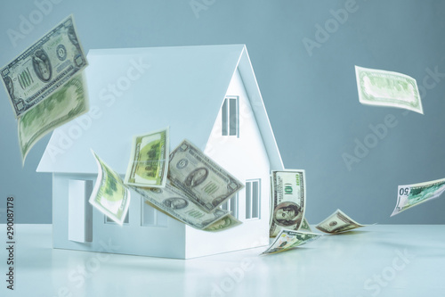Concept - investments of Real Estate. Passive income from the property. Real estate investor. Investing in the property. Commercial building. Money is falling on the house. Profitable real estate.