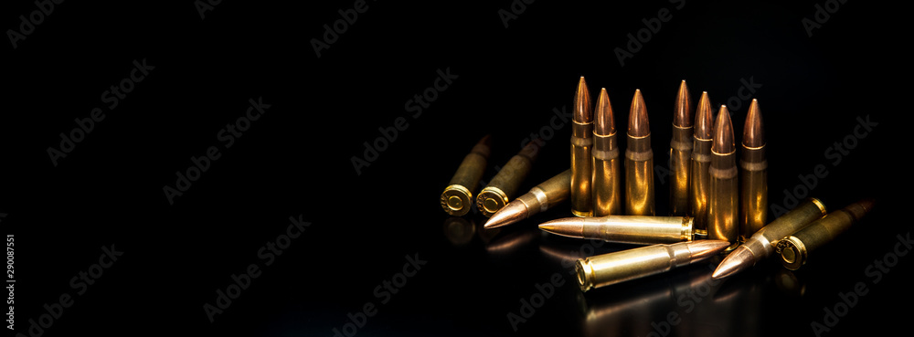 Fototapeta Bullet isolated on black background with reflexion. Rifle bullets close-up on black back. Cartridges for rifle and carbine on a black.