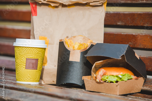burger in box with fry potatoes coffee cup. fast food