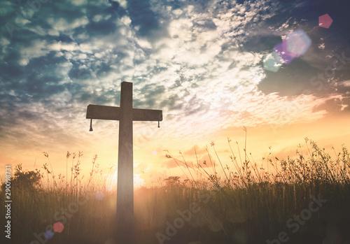 Fényképezés Ascension day concept: The cross on meadow autumn sunrise background