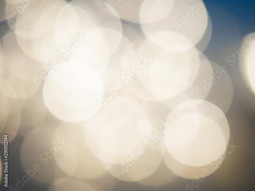 Fototapety, obrazy: Beautiful blurred bokeh light yellow on a blue background. Christmas concept.