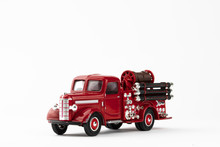 Vintage Red Fire Truck Toy On White Background