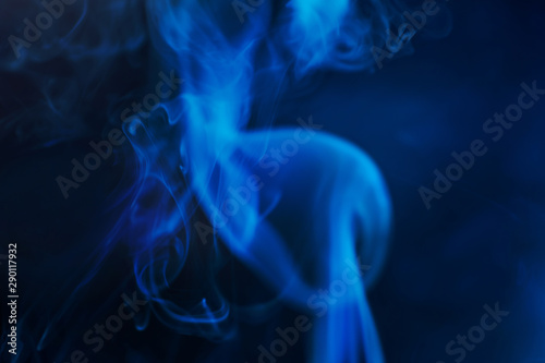 Smoke on a dark background in a mistery dark blue light. Minimalistic background concept. Copyspace. - 290117932