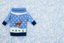 Christmas Sweater With A Reindeer And Snowflakes