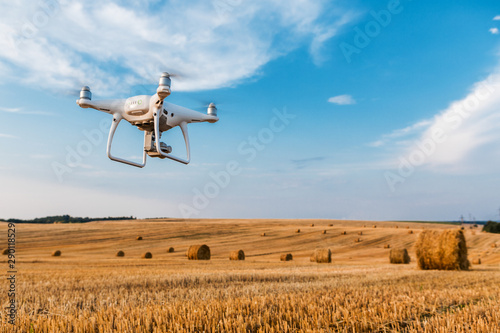 Fototapeta drone quad copter on yellow field obraz