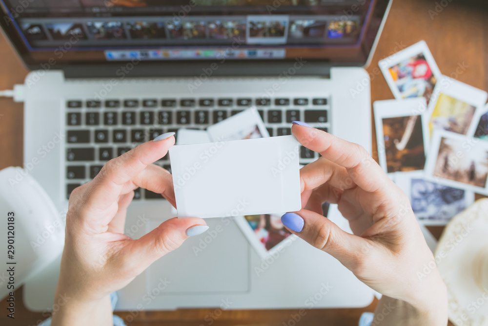 Fototapeta Woman Holding In Hands Instant Photo with place for photo of Your choice