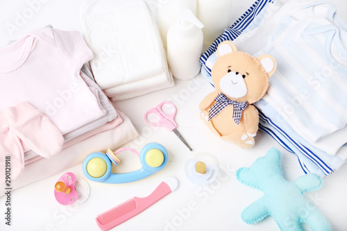 Vászonkép  Folded clothes with soft bear toy and baby supplies