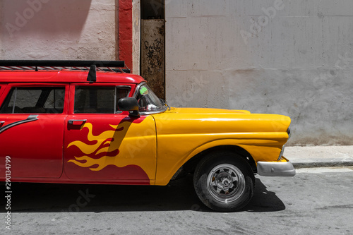 Traditional taxi in Havana Downtown waiting for customers in city sightseeing in authentic and stylish cars from the '60s Canvas Print