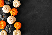 Autumn Pumpkin Side Border In Halloween Colors Orange, Black And White Against A Black Stone Background. Copy Space.