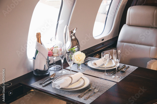 Fotomural modern and comfortable interior of business jet aircraft with decor
