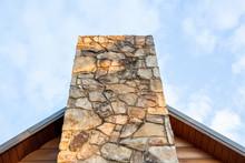 Stone Chimney On Log Cabin