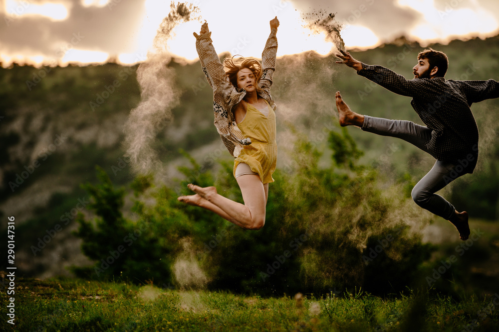 Fototapety, obrazy: Full length of an elegant couple dancing together over sunset sky