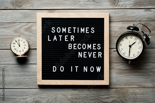Fotografía Inspirational motivational quote Sometimes later becomes never