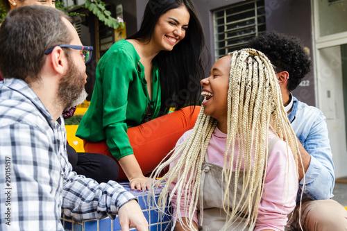Photographie  Multiethnic brazilian people having fun laughing and enjoying a joke in public area