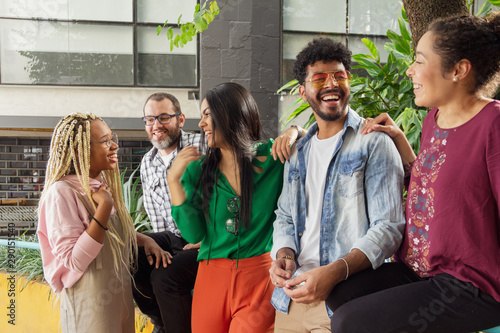Multiethnic brazilian people having fun and sitting in the outdoor Canvas
