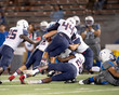 Leinwanddruck Bild - Great action photos of high school football players making amazing plays during a football game