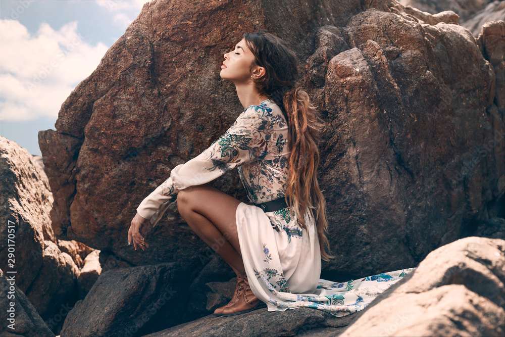 Fototapety, obrazy: beautiful young woman sitting on the stone