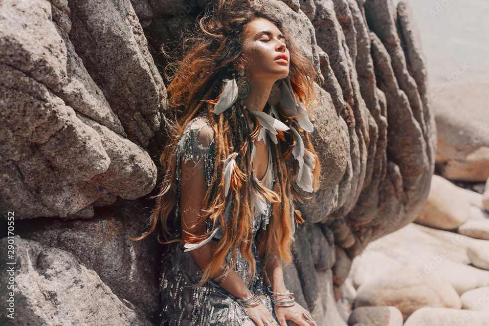 Fototapety, obrazy: beautiful young woman with feathers in hairoutdoors portrait