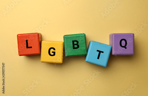 Photo Cubes with abbreviation LGBTQ on color background