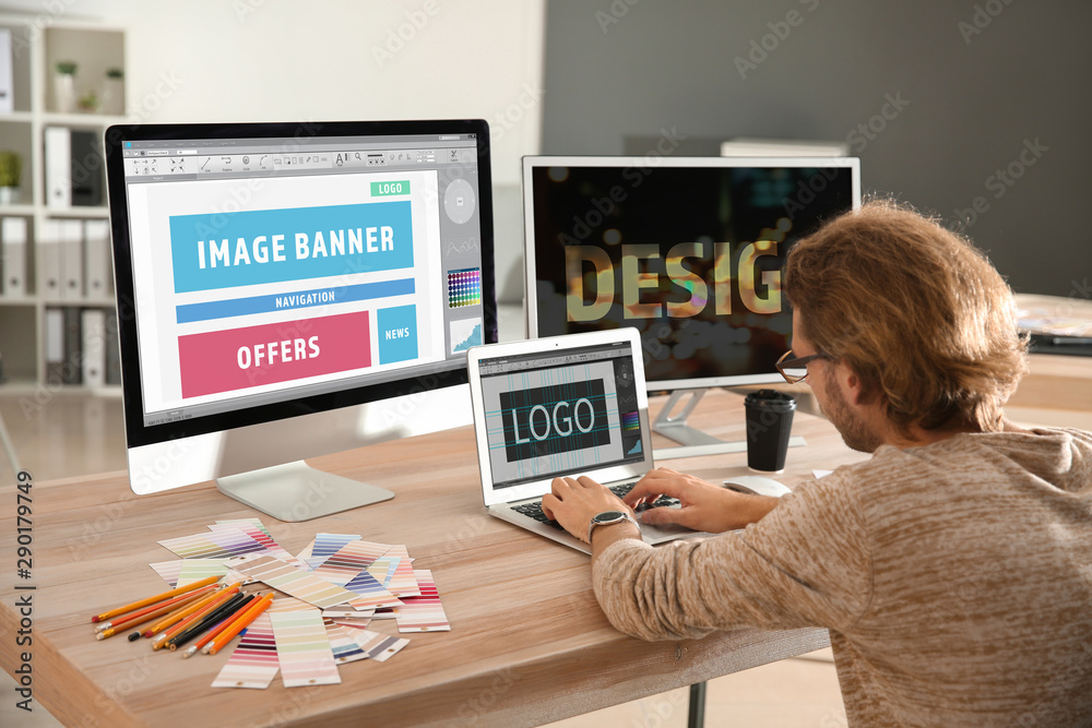 Fototapety, obrazy: Young designer working in studio