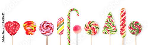 Different tasty lollipops on white background Tableau sur Toile