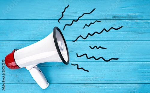 Photo  Megaphone on color wooden background