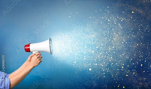 Photo Woman holding megaphone on color background