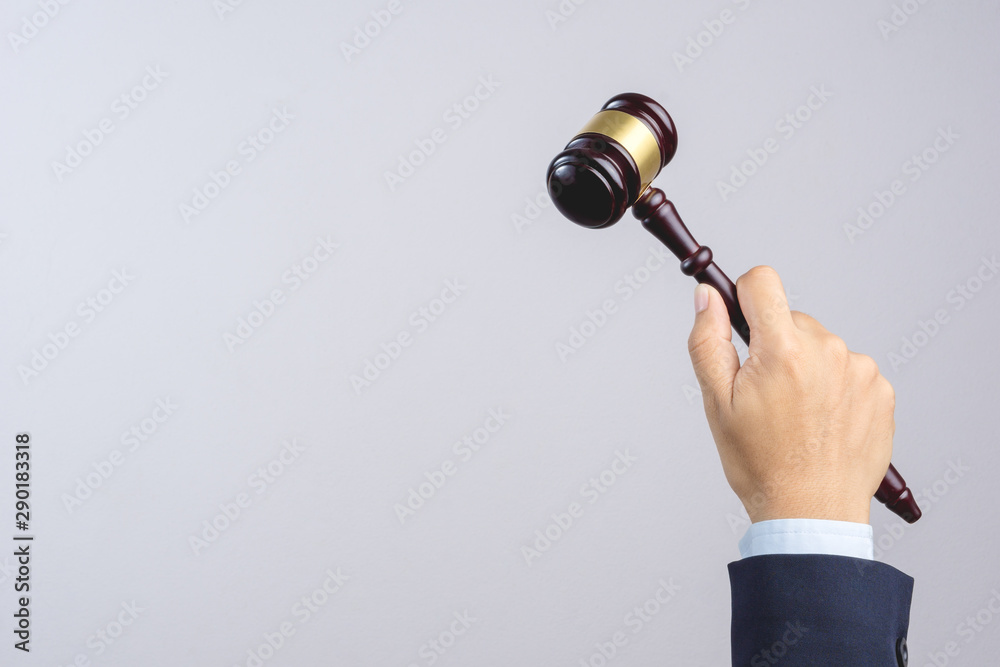 Fototapety, obrazy: Business man hand holding wooden judge's gavel as a law or justice sign