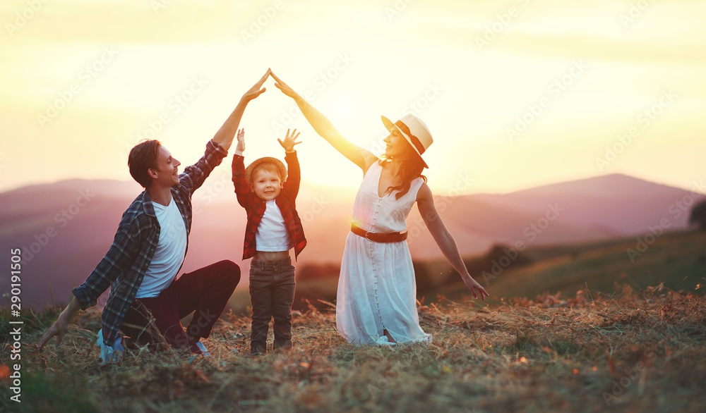 Fototapety, obrazy: Happy family father of mother and child son  on nature at sunset