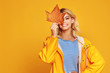 canvas print picture happy emotional girl with autumn leaves on colored yellow background.