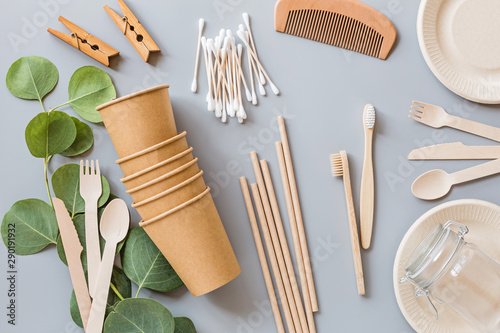 Obraz eco natural paper cups, straws, toothbrush flat lay on gray background. sustainable lifestyle concept. zero waste, plastic free items. stop plastic pollution. Top view, overhead, template, Mockup. - fototapety do salonu