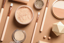 Flat Lay Composition With Makeup Brushes On Brown Background
