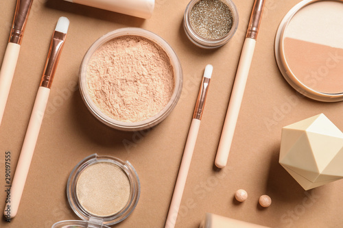 Fototapeta  Flat lay composition with makeup brushes on brown background