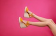 canvas print picture - Woman in stylish shoes on pink background