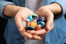 Young Woman Holding Many Beautiful Gemstones, Closeup