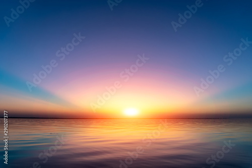 Sunset view above water - 290207377